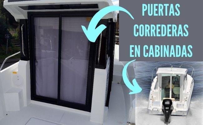 Detalle de puertas correderas en embarcación con cabina
